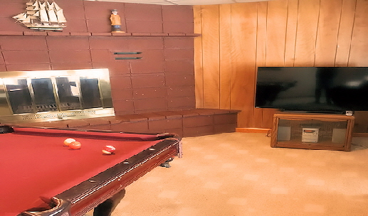 Walk Out Lower Level With Pool Table and Firelace & HDTV