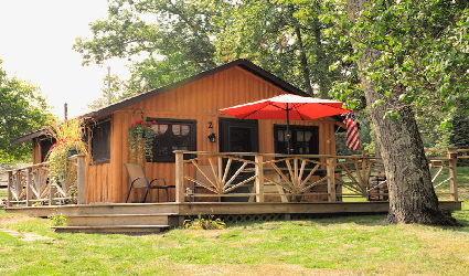 rentals cabins lakeside unitedstatesofamerica perfect cabin westbranch in city michigan near midwest families for bay rental